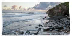 Sunset View In The Distance With Large Rocks On The Beach Bath Towel