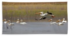 The American White Pelicans Hand Towel by Ernie Echols