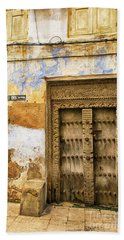 The Rustic Door Bath Towel by Amyn Nasser