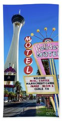 Bath Towel featuring the photograph The Stratosphere Casino In Front Of The Holiday Motel Sign by Aloha Art