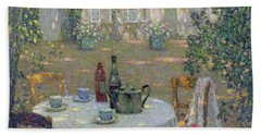 The Table In The Sun In The Garden Hand Towel by Henri Le Sidaner