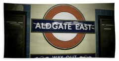 Hand Towel featuring the photograph The Tube Aldgate East by Christin Brodie