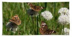 Three Buckeye Butterflies On Wildflowers Bath Towel by Sheila Brown