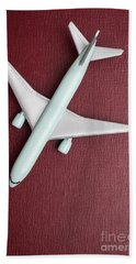 Bath Towel featuring the photograph Toy Airplane Over Red Book Cover by Edward Fielding