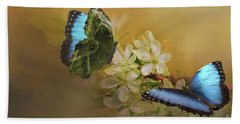 Two Blue Morpho Butterflies On White Spring Flowers Bath Towel by Janette Boyd