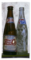 Two Pepsi Bottles On A Table Hand Towel