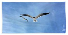 Two Seagulls Against A Blue Sky Hand Towel