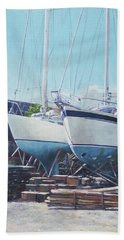 Bath Towel featuring the painting Two Yachts Receiving Maintenance In A Yard by Martin Davey
