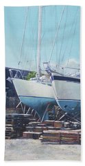 Hand Towel featuring the painting Two Yachts Receiving Maintenance In A Yard by Martin Davey