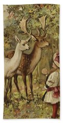 Two Young Children Feeding The Deer In A Park Bath Towel
