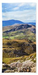 Undulating Green, Purple And Yellow Rocky Landscape In  Ireland Bath Towel by Semmick Photo