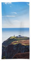 View Of The Trails On Howth Cliffs With The Lighthouse In Irelan Bath Towel by Semmick Photo