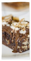 Walnut Brownie On A White Plate Hand Towel by Ulrich Schade