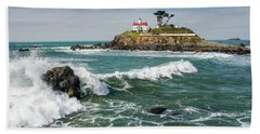 Bath Towel featuring the photograph Wave Break And The Lighthouse by Greg Nyquist