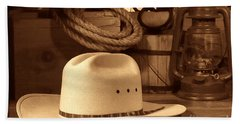 White Cowboy Hat On Workbench Bath Towel