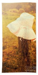 White Knitted Hat On Farm Fence Hand Towel