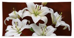 White Lilies On Red Bath Towel