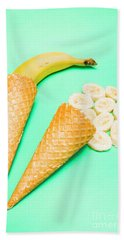 Whole Bannana And Slices Placed In Ice Cream Cone Bath Towel