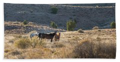 Hand Towel featuring the photograph Wild Horses In Monument Valley by Jon Glaser