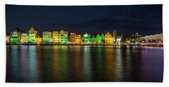 Hand Towel featuring the photograph Willemstad And Queen Emma Bridge At Night by Adam Romanowicz