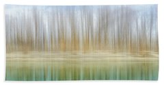 Winter Trees On A River Bank Reflecting Into Water Hand Towel
