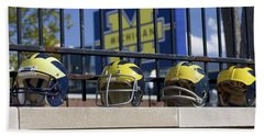 Wolverine Helmets Of Different Eras On Stadium Wall Bath Towel