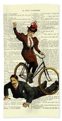Woman On Bicycle Riding Over Man Bath Towel