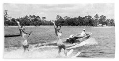 Women Water Skiers Waving Hand Towel