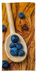 Wooden Spoon And Blueberries Hand Towel by Garry Gay