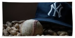 Bath Towel featuring the photograph Yankee Cap Baseball And Peanuts by Terry DeLuco