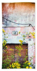 Bath Towel featuring the photograph Yellow Flowers And Decayed Wall by Silvia Ganora