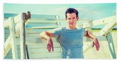 Young Man Relaxing On The Beach Hand Towel
