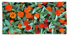 Hand Towel featuring the photograph Zinnia Flower - Profusion Orange by Janine Riley