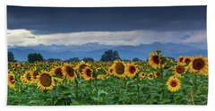 Bath Towel featuring the photograph Sunflowers Under A Stormy Sky by John De Bord