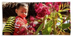 A Small Person With Reflected Flowers Hand Towel