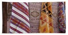 Bright Colored Patterns On Throw Rugs In The Medina Bazaar  Hand Towel
