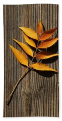 Bath Towel featuring the photograph Golden Autumn Leaves On Wood by Debi Dalio