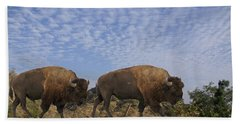 Group Of Bison Walking Against Rocky Mountains  Bath Towel