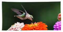 Hummingbird In Flight With Orange Zinnia Flower Bath Towel