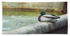 Mallard Resting On The Fountain Of The Fallen Angel In The Retiro Park - Madrid, Spain Bath Towel