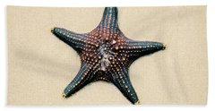 Starfish On The Beach Sand. Close Up. Hand Towel