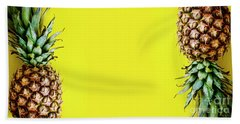 Top View Of Pineapple Border On Bright Yellow Background. Vivid  Hand Towel