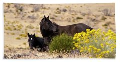 Two Wild Black Horses Among Yellow Flowers Hand Towel