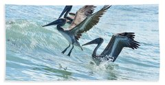Wave Hopping Pelicans Bath Towel