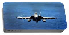 Portable Battery Charger featuring the photograph  A Fa-18 Hornet Demonstrates Air Power. by Paul Fearn