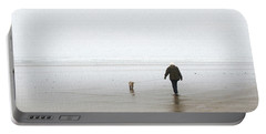 At The Beach On A Foggy Day Portable Battery Charger by Tom Janca