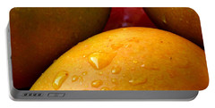 Portable Battery Charger featuring the photograph  Tres Mangoes by Greg Allore