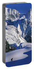 A Female Snowboarder Hiking Portable Battery Charger