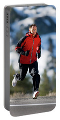 A Man Runs Alone On A Late Winter Day Portable Battery Charger