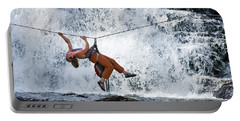 A Woman Crosses A Waterfall Using Portable Battery Charger